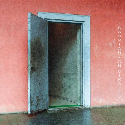 Album Art to Circles- an open, shadowy door with a faded cyan trim in the center of a peace-colored wall.